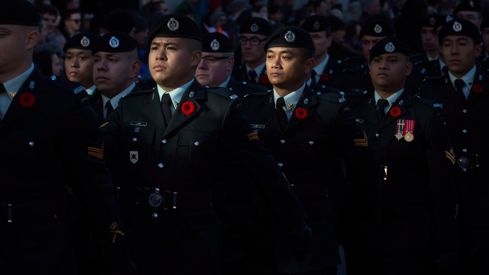 Members of the Canadian Forces march together during a Remembrance Day ceremony at Victory Square in Vancouver, B.C., on Tuesday November 11, 2014. (Darryl Dyck / THE CANADIAN PRESS)