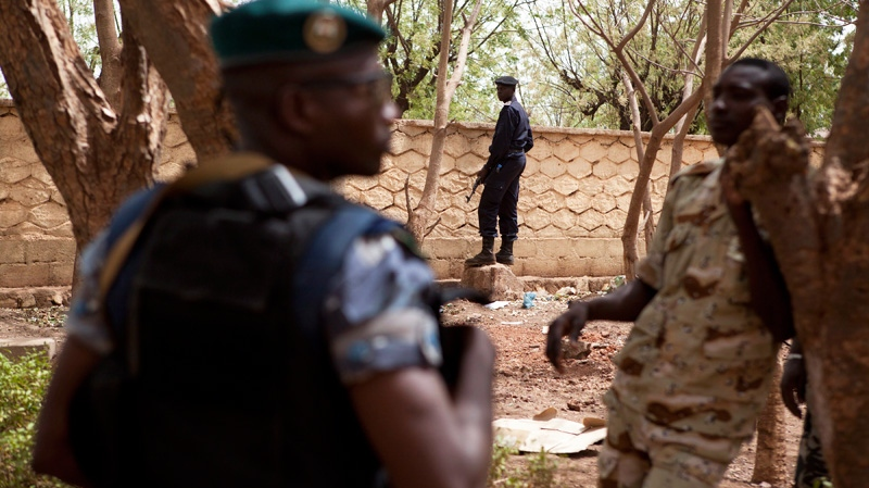 Soldiers stand guard to secure the perimeter while coup leader Capt. Amadou Haya Sanogo, not pictured, addresses journalists at junta headquarters in Kati, outside Bamako, Mali