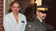 Allan Legere departs from court in Burton, N.B. as he waits for jurors in his murder trial to return a verdict on Nov. 2, 1991. (The Canadian Press/Andrew Vaughan)
