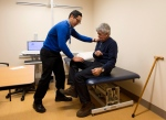 Cancer patient Nick Marks, right, does a strength test exercise with Dr. Eugene Chang at Toronto Rehab on Thursday, Nov. 20, 2014. (Nathan Denette / THE CANADIAN PRESS)