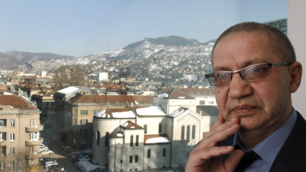In this Wednesday, March 7, 2012 photo Bosnian Roma activist Dervo Sejdic poses for a photo during an interview with the Associated Press in Sarajevo, Bosnia.