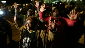 Barbara Jones, joined by other protesters, raises her hands, in Ferguson, Mo., Monday, Nov. 24, 2014. (AP / Charlie Riedel)
