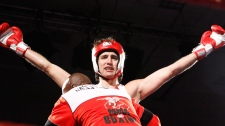 Liberal MP Justin Trudeau celebrates after he defeated Conservative Senator Patrick Brazeau during charity boxing match for cancer research in Ottawa, Saturday, March 31, 2012. (Fred Chartrand / THE CANADIAN PRESS)