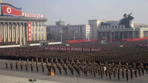 Soldiers and citizens rally at Kim Il Sung Square in Pyongyang, North Korea, to protest a United Nations resolution condemning their country's human rights record Tuesday, Nov. 25, 2014. (AP / Jon Chol Jin)