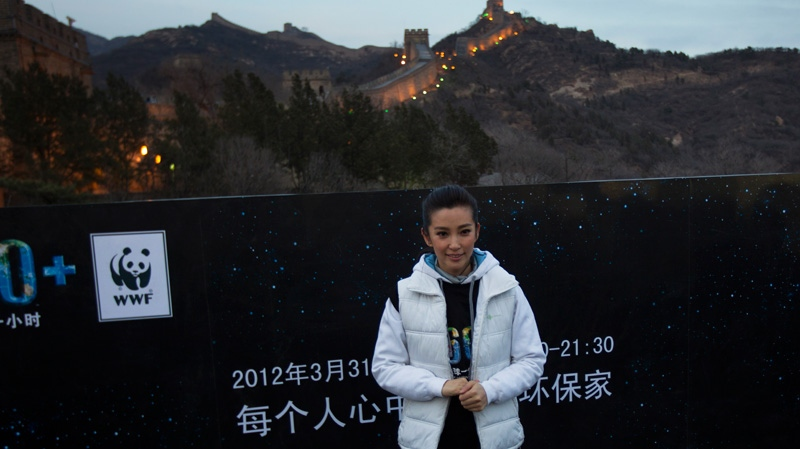 Chinese actress Li BingBing poses before a mini marathon in conjunction during the Earth Hour
