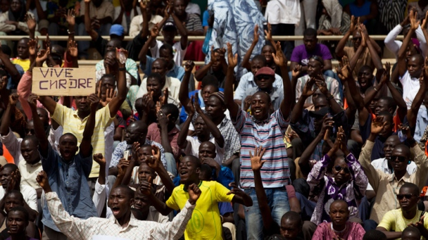 People cheer during a rally in support of the ruling military junta, attended by roughly one thousand people in a stadium with a capacity of 50,000, in Bamako, Ma