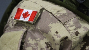 A Canadian flag sits on a member of the Canadian Armed Forces in this file photo. (Lars Hagberg/The Canadian Press)