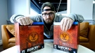 Lewis Hilsenteger of Toronto unboxes the recently released Far Cry 4 Kyrat Edition video game set. (AP Photo/Courtesy of Lewis Hilsenteger)