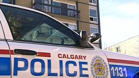 A Calgary Police Service cruiser sits is shown in front of a building where a toddler went through a window screen and fell five stories on Sunday, April 1, 2012.b