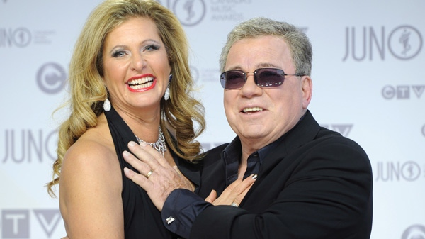 Host William Shatner holds on to his wife Elizabeth Anderson Martin on the red carpet at the Juno Awards in Ottawa, Sunday April 1, 2012. (Sean Kilpatrick / THE CANADIAN PRESS)