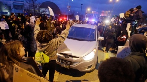 Demonstrators surround a car on Memorial Shoreway in Cleveland. Tuesday, Nov. 25, 2014, in a protest over the weekend police shooting of Tamir Rice. (AP / Mark Duncan)