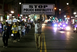 Cliff Rogers, of East Orange, N.J., marches with organizers during a rally in response to news of a grand jury deciding not to indict a Missouri police officer in the killing of Michael Brown on Tuesday, Nov. 25, 2014, in Newark, N.J. (AP / Julio Cortez)