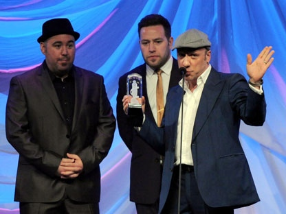 Members of MonkeyJunk receive the Juno for Blues Album of the Year for their album To Behold during the Juno Gala dinner in Ottawa on Saturday, March 31, 2012. THE CANADIAN PRESS/Sean Kilpatrick