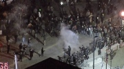 Extended: Thrown object scatters protesters