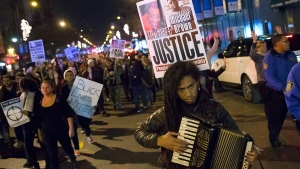 Demonstrators march in protest against a grand jury's decision on Monday not to indict Ferguson police officer Darren Wilson in the fatal shooting of Michael Brown, in New York, Tuesday, Nov. 25, 2014. (AP / John Minchillo)