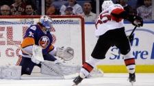 Ottawa Senators' Sergei Gonchar, right, scores a goal past New York Islanders goalie Al Montoya during the second period of the NHL hockey game on Sunday, April 1, 2012, in Uniondale, N.Y. (AP Photo/Seth Wenig)