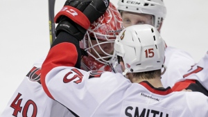 Ottawa Senators goalie Robin Lehner is congratulated by teammates after beating the St. Louis Blues in a shootout on Nov. 25, 2014 in St. Louis. (AP / Tom Gannam)