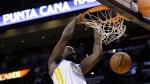 Golden State Warriors forward Draymond Green dunks over Miami Heat forward Shawne Williams on Nov. 25, 2014, in Miami. (AP / Lynne Sladky)
