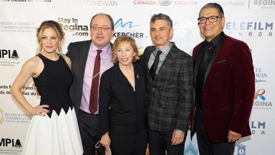 Tara Spencer-Nairn, left to right, Brent Butt, Nancy Robertson, Fred Ewanuick and Lorne Cardinal pose on the red carpet during the world premiere of 'Corner Gas: The Movie' held at The Sound Stage in Regina, Saskatchewan on Tuesday, November 25, 2014. (THE CANADIAN PRESS/Michael Bell)