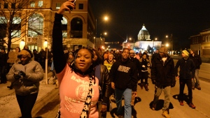 Lataijah Powell, 17, from, Minneapolis, is among hundreds of people marching up University Avenue in St. Paul, Minn., Tuesday, Nov. 25, 2014, in Ferguson, Mo. (AP / St. Paul Pioneer Press, John Autey)