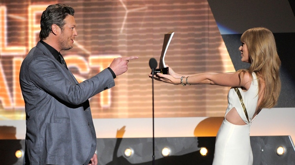 Taylor Swift, right, presents the award for male vocalist of the year to Blake Shelton at the 47th Annual Academy of Country Music Awards on Sunday, April 1, 2012 in Las Vegas. (AP / Mark J. Terrill)