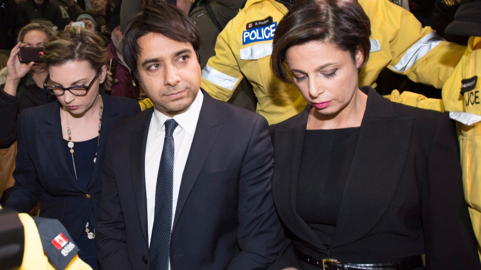 Jian Ghomeshi leaves court in Toronto, Wednesday, Nov. 26, 2014.  (Nathan Denette / THE CANADIAN PRESS)