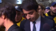 Extended: Ghomeshi exits court surrounded by media