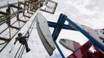 Alberta surplus shrinks as oil prices sag