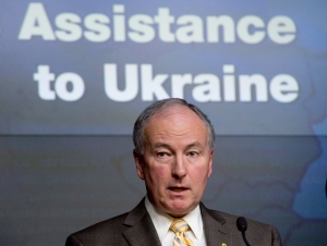 Defence Minister Rob Nicholson announces support for military forces in the Ukraine during a news conference in Ottawa on Wednesday, Nov. 26, 2014. (Adrian Wyld / THE CANADIAN PRESS)