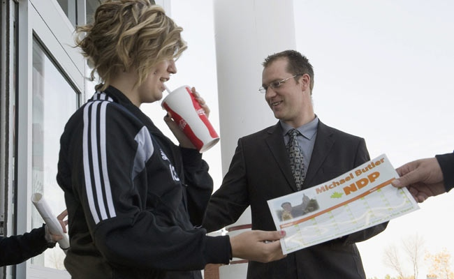 NDP candidate Mike Butler hands out promotional material in the Edmonton, Alberta bedroom community of Millwoods, on Friday, September 19, 2008. (THE CANADIAN PRESS / John Ulan)