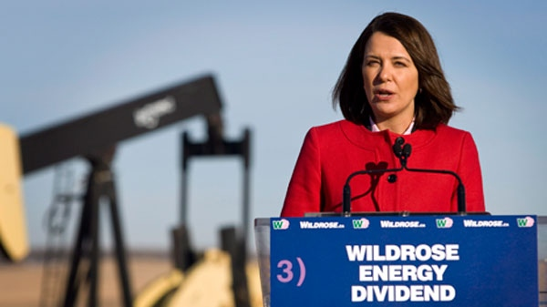 Wildrose Leader Danielle Smith makes a campaign stop with an oil and gas pumpjack the background near Cremona, Alta., Monday, April 2, 2012. (Jeff McIntosh / THE CANADIAN PRESS)