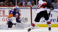 Ottawa Senators' Sergei Gonchar, right, scores a goal past New York Islanders goalie Al Montoya during the second period of the NHL hockey game on Sunday, April 1, 2012, in Uniondale, N.Y. (AP Photo/Seth Wenig)
