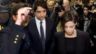 Jian Ghomeshi makes his way through a mob of media with his lawyer Marie Henein (right) at a Toronto court Wednesday, Nov. 26, 2014. (Nathan Denette / THE CANADIAN PRESS)