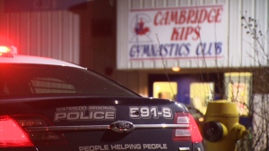 A police cruiser sits outside the Cambridge Kips Gymnastics Club on Wednesday, Nov. 27, 2014.