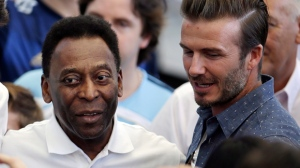 From left to right Brazil's former soccer player Zico, Brazil's player Kaka, Brazilian soccer legend Pele and former English player David Beckham have their picture taken as they arrive to attend the World Cup final soccer match between Germany and Argentina at the Maracana Stadium in Rio de Janeiro, Brazil, Sunday, July 13, 2014. (AP Photo/Hassan Ammar)