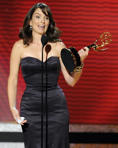 Tina Fey accepts the award for outstanding writing for a comedy series for her work on the '30 Rock' at the 60th Primetime Emmy Awards Sunday, Sept. 21, 2008, in Los Angeles. (AP Photo/Mark J. Terrill)