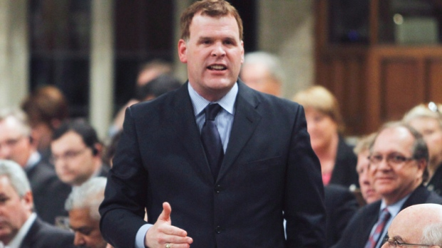 Foreign Affairs Minister John Baird stands in the House of Commons during question period in Ottawa on Friday, March 30, 2012.