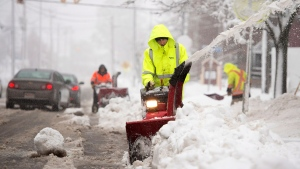 Workers clear sidewalks in Moncton N.B. on Thursday, Nov. 27, 2014. (Andrew Vaughan / THE CANADIAN PRESS)