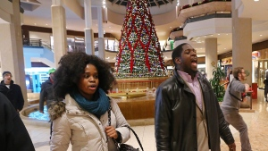 Protesters of the grand jury decision in the Michael Brown shooting march through the St. Louis Galleria mall, in Richmond Heights, Mo., Wednesday, Nov. 26, 2014. (AP / St. Louis Post-Dispatch, J.B. Forbes)