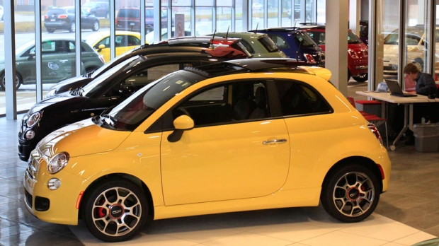 In a Feb. 29, 2012 photo, Fiat 500 vehicles are displayed at the Golling Fiat dealership in Birmingham, Mich. Chrysler Group was the first automaker to report sales Tuesday, April 3, 2012. Its U.S. sales jumped 34 percent in March on strong sales of Fiat small cars and Chrysler sedans. (AP Photo/Carlos Osorio)
