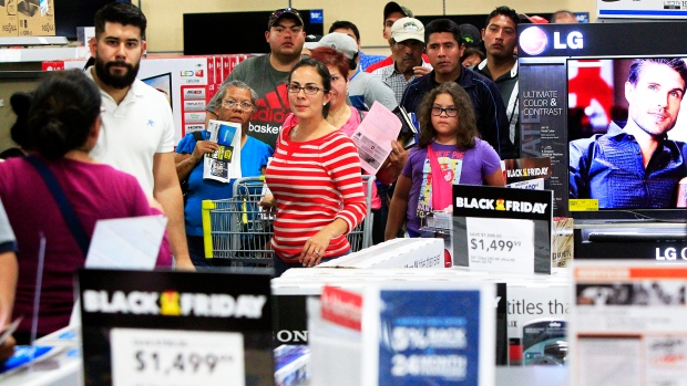 Customers stand in line as they wait to receive a television during Black Friday sales at Best Buy in McAllen, Texas on Thursday Nov. 27, 2014. <br> <br> It&#39;s not quite Friday, but that isn&#39;t stopping shoppers from flocking to retail stores for Black Friday deals across the U.S. (The Monitor / Gabe Hernandez)