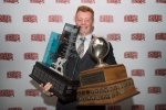 Andrew Buckley, from the University of Calgary, holds up his Russ Jackson Centaur trophy, left, and trophy for most outstanding player of the year during the CIS football awards ceremony in Montreal, Thursday, November 27, 2014. (THE CANADIAN PRESS/Graham Hughes)