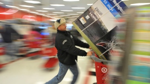 A shopper at a Plainville, Mass., Target store early Friday morning, Nov. 28, 2014.  (AP / The Sun Chronicle, Mark Stockwell)