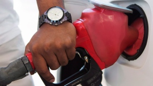 A person pumps fuel in Toronto after gasoline prices rose overnight on Wednesday, Sept. 12, 2012. (Michelle Siu / THE CANADIAN PRESS)