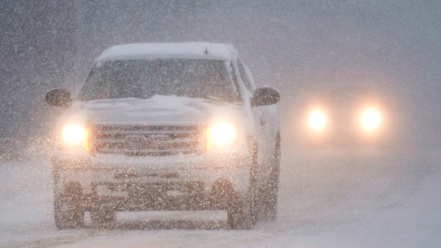 Motorists make their way along a country road near Montreal on Dec. 27, 2012 (THE CANADIAN PRESS / Graham Hughes)