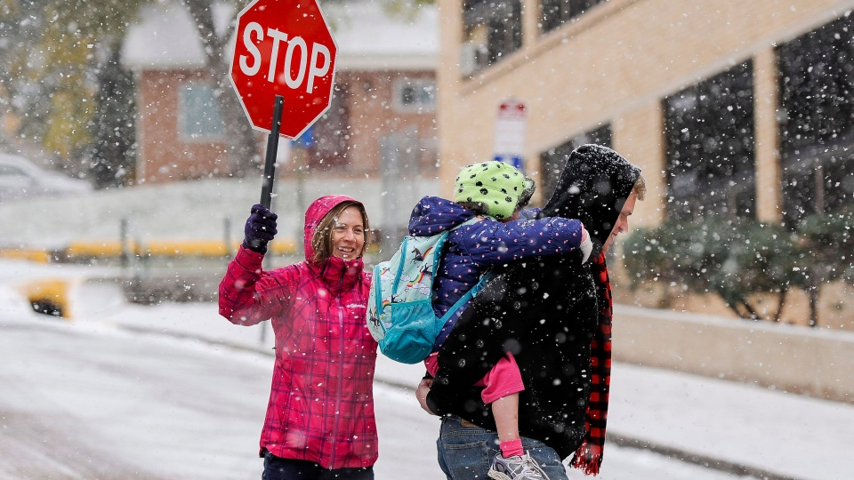 A group of parents are protesting a Peterborough, Ont. bylaw that bans children from high-fiving their crossing guards while walking to school.