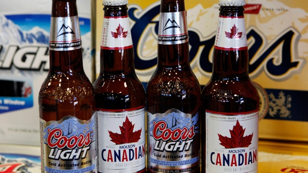 Coors Light and Molson Canadian bottles of beer are displayed in Denver, Nov. 1, 2010. (AP / Ed Andrieski)