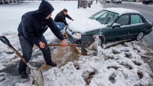 Digging out a car that was stuck on snow and ice during a winter storm in Greensboro, N.C., on March 7, 2014. (AP / News & Record, H. Scott Hoffmann)