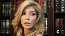 Jenna Talackova, who advanced to the finals of the Miss Canada competition, part of the Miss Universe contest, and was recently forced out of the competition, appears with her attorney Gloria Allred