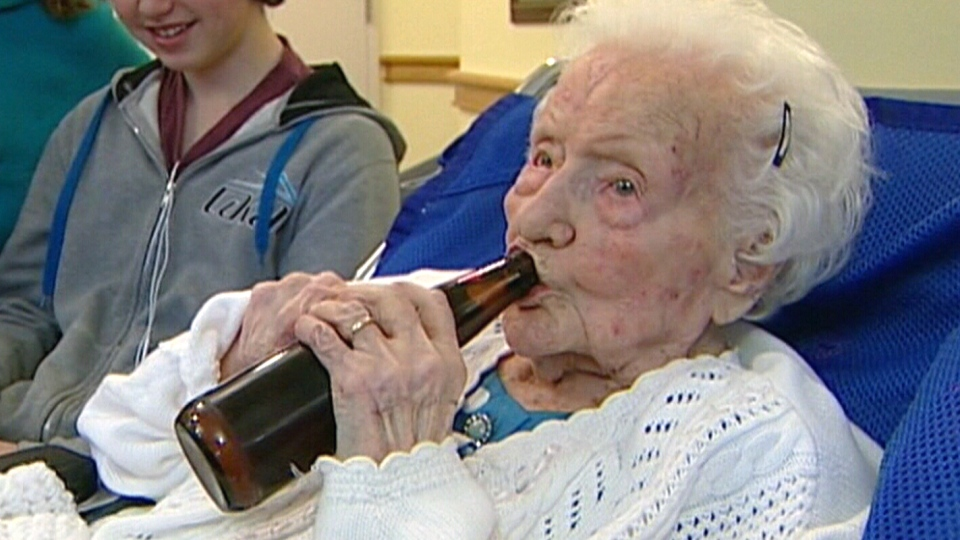 Merle Barwis enjoys a cold beer on her 111th birthday in December, 2011.